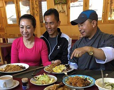 Christina, Chong and driver Kalu eating delicious food