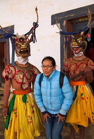 Tourist posing with dancers