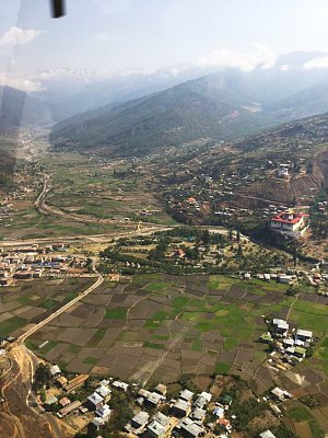 Flying over Paro dzong