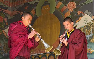 Monks playing trumphets
