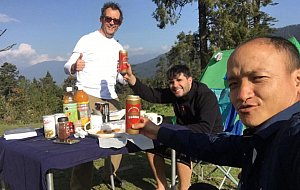 Renato, Andre and their guide Dawa enjoying the refreshments on the trek