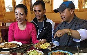 Christina, Chong and driver Kalu eating delicious food