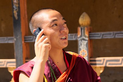 Monk talking phone